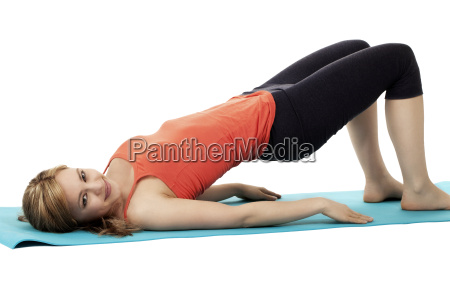 young sportswoman with fitness exercises