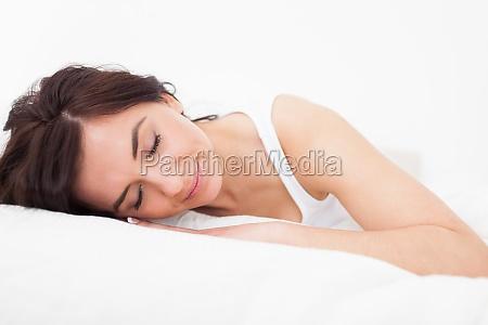 brunette woman falling asleep in her