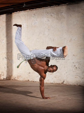 agile african martial artist kicking