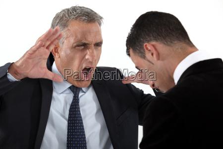 boss shouting at useless employee