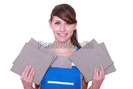 portrait of a woman holding tiles