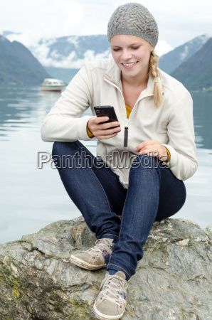 young blonde woman with her smartphone