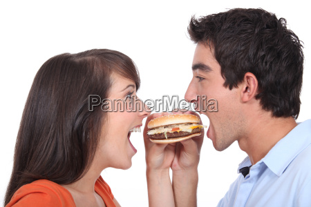 young people eating hamburger