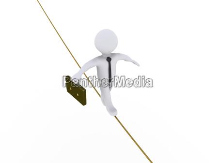 businessman is walking on tightrope