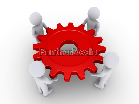 four people holding cog