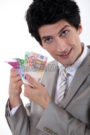 banker holding bank notes
