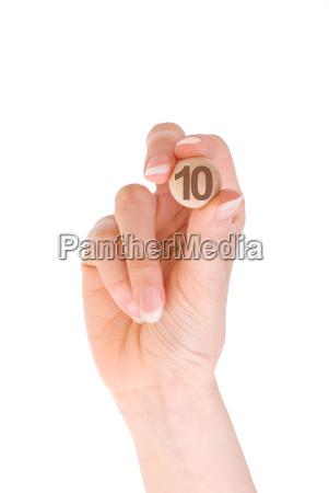 10 bingo ball in the hand