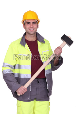 traffic guard holding a mallet