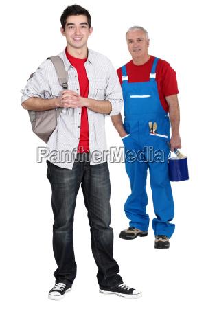 senior craftsman and apprentice posing