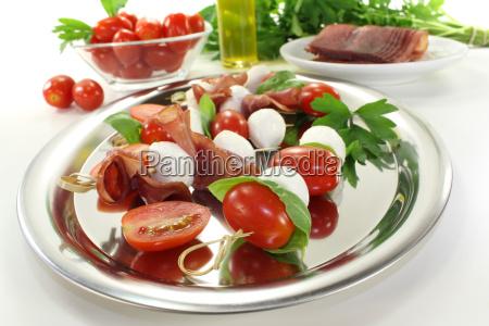 delicious tomato mozzarella ham skewers