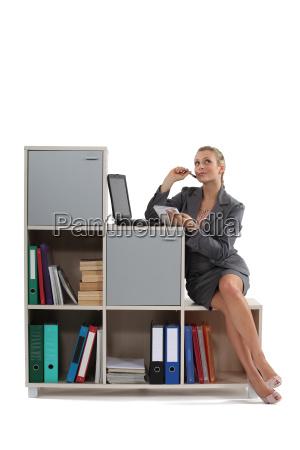attractive blonde working on laptop indoors