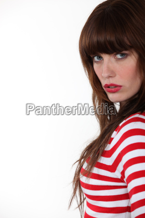 gorgeous brunette standing on white background