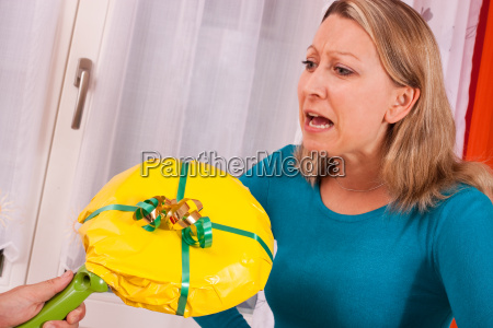 young blonde woman gets loveless gift