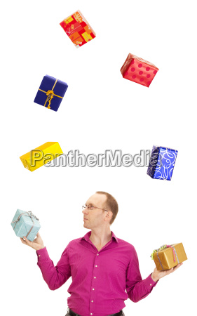 a business person juggling with some