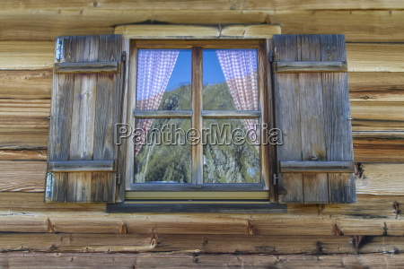 wooden hut with windows in the