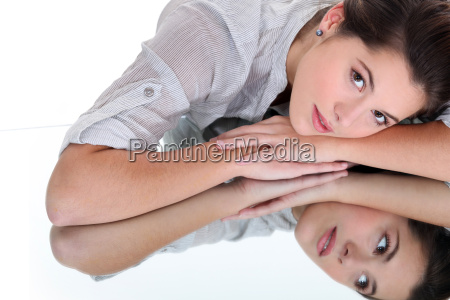 young woman resting her head on