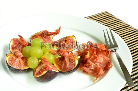 fresh figs wrapped with south tyrolean