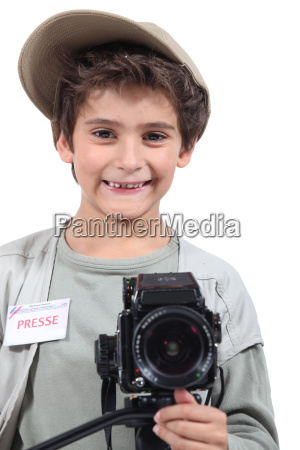 young boy dressed as a press