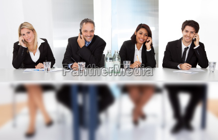 business people talking on the phones