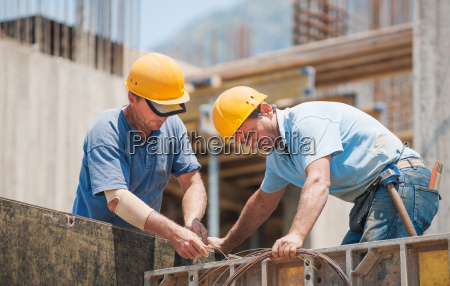 construction workers working on cement formwork