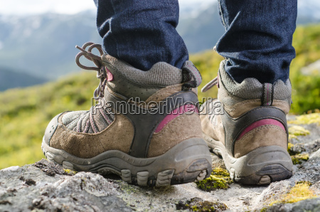 two hiking boots before mountain landscape