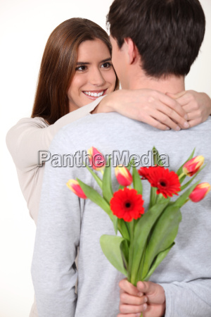 man surprising his girlfriend with a