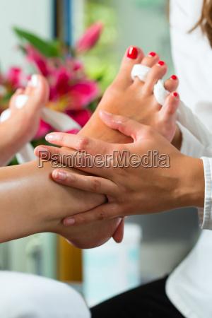 woman in cosmetics studio receives pedicure