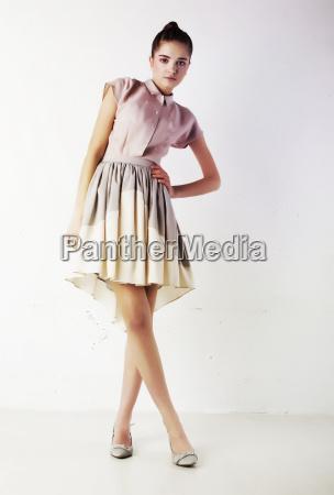 stylish brunette female in fashion dress