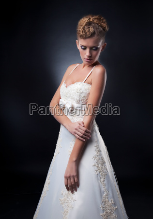 fashion young woman posing in white
