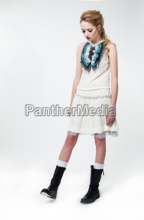 sad fashion model woman standing studio