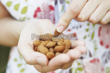 close up of woman eating handful