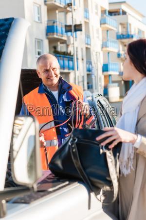woman searching her purse mechanic fixing