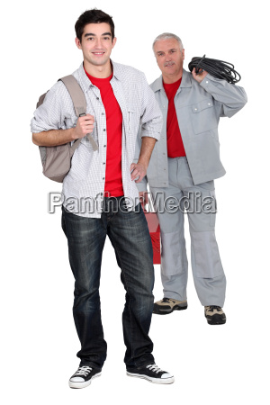 apprentice electrician and senior craftsman standing