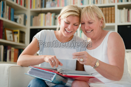 mother and daughter looking at pictures