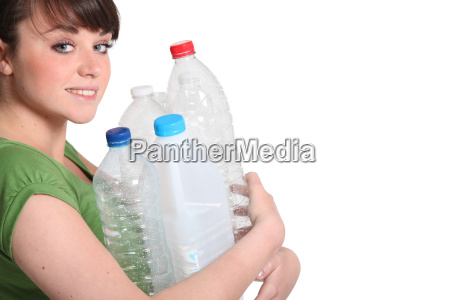 woman about to recycle plastic bottles