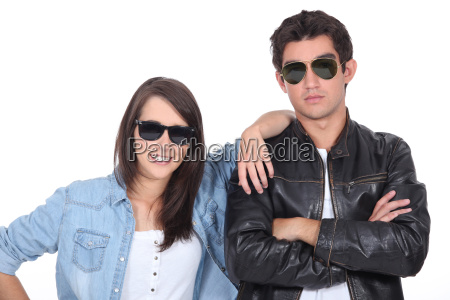 young couple posing in sunglasses and