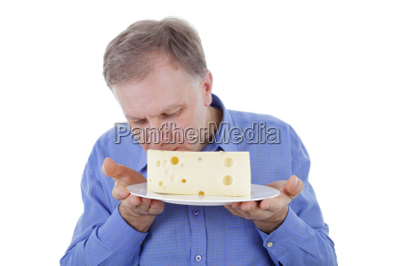 handsome man eating cheese