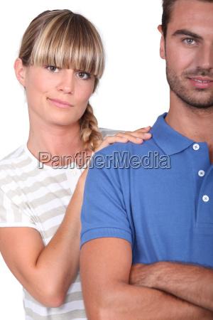 an unsure woman touching her husbands