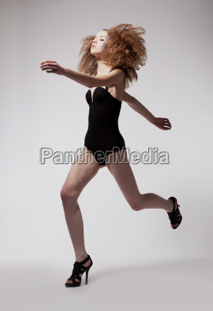 red hair sporty fashion woman running