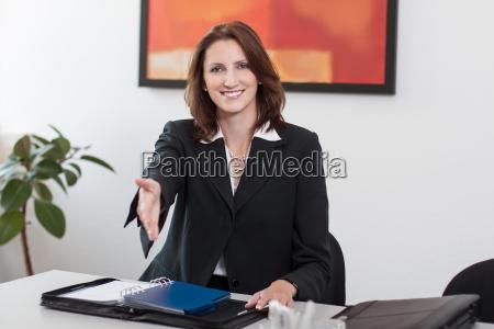 attractive businesswoman shakes hands