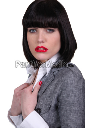 woman holding her jacket