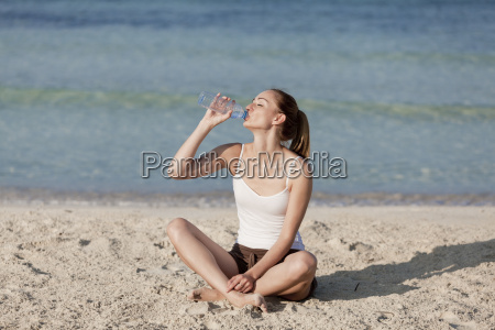 woman, drinking, water, from, a, bottle - 7969129