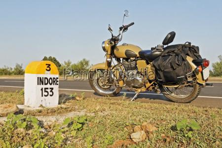 153kms indore milestone parked motorbike