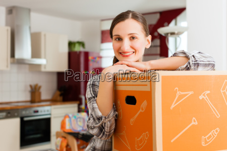 woman with moving box when moving