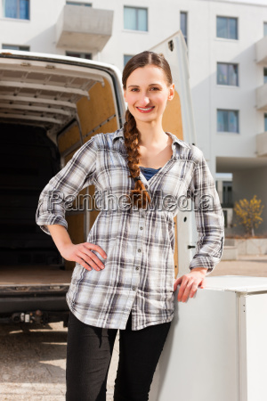 woman before moving truck while moving