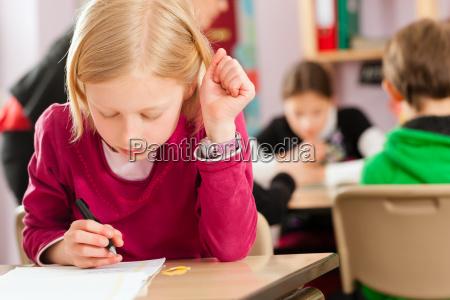 schoolchildren and teacher learning at school