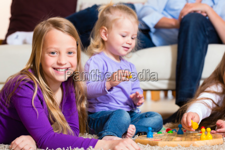 family playing ludo