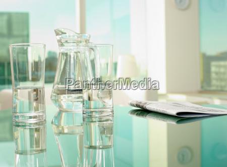 glassware and newspaper