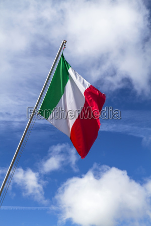 italian flag in front of blue