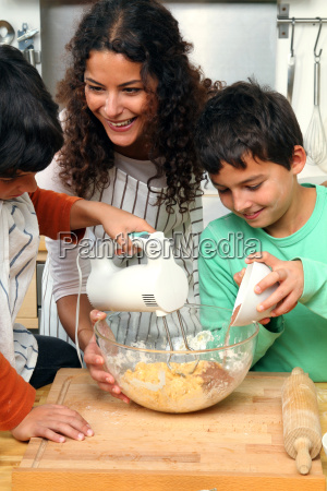 mother with children in the kitchen